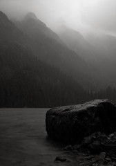 autumn storm, avalanche lake (Chris Lombardi) Tags: autumn bw lake storm rain rock montana solitude glacier glaciernationalpark avalanche quietude monochromitude 3545435