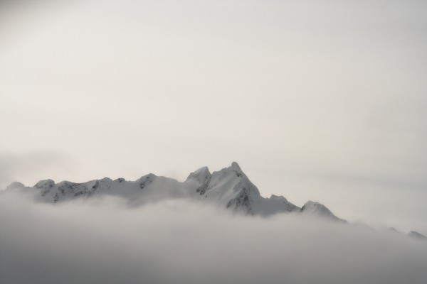 Snow peeks through clouds