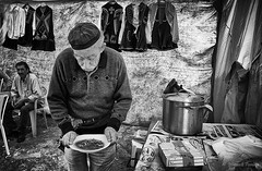 Lunch time... (Ipapanti Tomara) Tags: street people blackandwhite bw festival feast pentax grandfather streetphotography grandpa repast