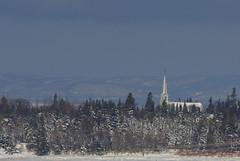 The church on the river (Natimages) Tags: church winter winterscene mountains river riverside charlevoix rivièreduloup québec snow blue bluesky white pentaxk3 da3004