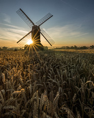 Waiting for the harvest (grbush) Tags: shadow england sun mill windmill field sunshine rural sunrise dawn countryside farm wheat bedfordshire sunburst daybreak postmill stevington stevingtonwindmill tokinaatx116prodxaf1116mmf28 sonyslta77