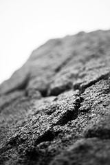 Foreboding (belleshaw) Tags: blackandwhite simpsonpark hemet boulder rock cracked sky fog storm winter cold monolith rough texture abstract detail bokeh