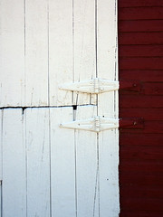 Hinges on a Red Barn (Jae at Wits End) Tags: door hinge wood old red white building nature metal architecture barn rural outside handle hardware rust midwest colorado exterior outdoor decay farm country rustic shed entrance rusty structure minimal doorway entryway worn weathered opening portal aged plains knob oxidize entry storehouse corroded passageway outbuilding farmbuilding fortmorgan ftmorgan