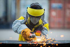 Employee grinding steel with sparks (anekphoto) Tags: employee grinding steel sparks grinder production industrial operation factory repair safet job work working occupation career vocation business profession employment metier mechanic tool grind workshop die manual technical spark engineering welding treatment worker technology equipment labour protection safety saw manufacturing cut machine labor part industry construction manufacture hand metal disc