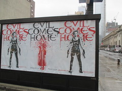Resident Evil - Evil Comes Home Movie Poster 9805 (Brechtbug) Tags: resident evil comes home movie poster billboard sidewalk display destruction milla jovovich video game film nyc 12292016 new york city cinema marquee flickr motion december 2016 black white red graphic illustration scifi science fiction post apocalyptic future dystopia futuristic war zone female warrior amazon amazonian