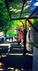 Walking food cart row (TMimages PDX) Tags: city people urban usa oregon portland geotagged photography photo downtown image streetscene explore sidewalk photograph pedestrians everydaylife fineartphotography foodcarts flickrexplore explored iphoneography
