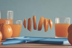 Floating orange (Ali Llop) Tags: blue stilllife orange azul fruta naranja vaso zumo levitación floatingfruit