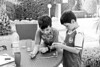 Losing the Thread (The_Kevster) Tags: 2016 cyprus paphos coralbay boys children kids brothers twins portrait football table garden villa bokeh beads necklace footballstrip arsenal manchesterunited leaves trees monochrome bw blackandwhite
