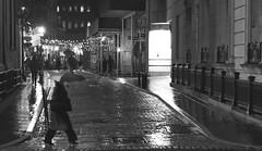 Stepping (Lojones13) Tags: rain walking umbrella street outdoor night newyork blackandwhite road