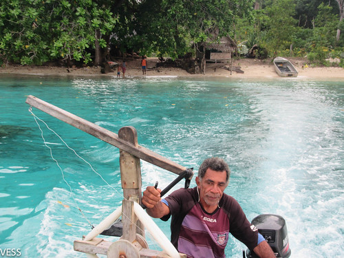 Fisherman on his boat with gear