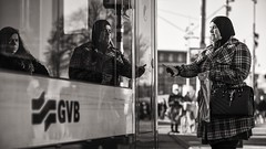 about to take the tram (Gerard Koopen) Tags: nederland netherlands amsterdam city centraalstation centralstation cs tram gvb woman reflection bw blackandwhite straatfotografie streetphotography straat street candid fujifilm fuji xpro2 56mm 2016 gerardkoopen