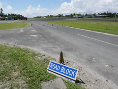 When the fligh is closing Tuvalu they close the road that normaly is crossing the airstrip.