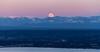 Smothered in alpenglow. (Brendinni) Tags: moon wolfmoon cascades 520floatingbridge trees valley landscape alpenglow pink blue green orange luna wow