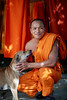 Buddhist Monk with dog, Battambang, Cambodia (Alex_Saurel) Tags: adult travel body type traditional pose clothes plantaille religion photoreport reportage photoreportage vertical man archicategory cambodge photojournalism moine bouddhisme day time drape people asia arm buddhist scans portray orientation portraiture halfbody portrait kesa monk shavedhead cheek posing imagetype culture photospecs buddhism shaved chien shoulder animal stockcategories dog tradition detail pleinformat face fullframe sony50mmf14sal50f14