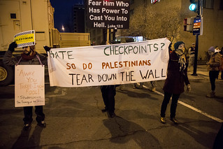 Hate Checkpoints? So Do Palestinians. - Protesters Hold a Banner Over a Street Preacher's Bullhorn Outside the Presidential Inauguration of Donald Trump