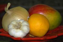 A Plate of Sustenance (swong95765) Tags: food plate fruit mango onion garlic orange bokeh