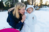 Tasting the snow (Graham Gibson) Tags: sony a7rii sel28f20 28mm f2 282 snow icy lake tahoe snowsuit baby toddler