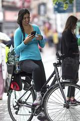 She likes it (Frank Fullard) Tags: frankfullard fullard candid bike bicycle mobile phone message street dublin news goodnews text pause happy