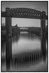 Latchford Locks (4 of 8) (andyyoung37) Tags: latchfordlocks manchestershipcanal reflections uk warrington bridge cheshire oldrailwaybridge sunset