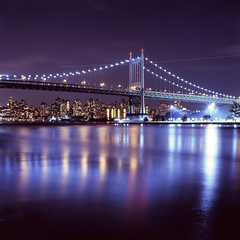 Triborough Bridge (Rafakoy) Tags: minoltaautocord rokkor75mmf35 75mm fujichromet64 e6 epsonperfectionv600 scan film newyork ny queens astoria night longexposure reflections water cityscape skyline city urban lights color tungsten slide positive expired 6x6 square tlr bridge uppereastside bronx randallsisland dusk