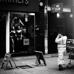 Outside the 100 Club (stevedexteruk) Tags: anne summers ann lingerie shop store window display mannequine dummy man working mobile phone london city westminster uk street 100 club music venue 100club 2017 square squareformat 1x1