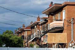 Balconville (caribb) Tags: city morning homes urban canada architecture buildings apartments montréal quebec montreal sunny québec balconies stleonard staircases metropolitan ville eastend stléonard duplexes windingstaircases duplexe