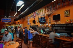 Cigar City Brewing Company. So many beers, so little time... (beyondhue) Tags: cigar city brewing company brewery tampa florida bar tap beer beyondhue travel indoors interior prizes medal people order sample drink alcohol draft tour