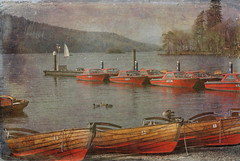 The old lake... (zapperthesnapper) Tags: uk red england lake texture water rural vintage boats view lakedistrict scene cumbria lakewindermere woodenboats oldboats redboats rowingboats overlaidimage