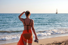 Woman in an orange scarf on the beach 1 (Romeodesign) Tags: travel summer vacation orange woman holiday beach beauty female scarf turkey happy freedom fly back seaside healthy model mood ship wind outdoor side horizon watch rear young free happiness sunny bikini shore leisure concept