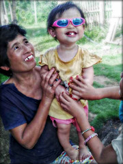 Tickled McKayla! (Chris C. Crowley- grieving and recovering) Tags: family friends people baby cute girl sunglasses women toddler child grandmother teeth philippines mother smiles littlegirl mckayla editbychriscrowley tickledmckayla