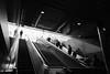 Moving Up, Going Down (Torsten Reimer) Tags: deutschland europa people germany munich bayern stachus münchen contrast escalators spiegelungen sonyrx100iv reflektionen bavaria reflections schwarzweis europe rolltreppe blackandwhite de