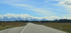 Road to Tekapo (davidbailey12) Tags: nz new zealand lake tekapo alps snow road grass blue white scenery views mountains clouds bitumen paint trip ambience
