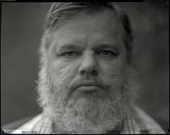 Jason Rohrbacker shot on graflex 4x5 (Garrett Meyers) Tags: garrettmeyers garrett meyers film 4x5 ilford hp5 beard jason lf largeformat graflex filmportrait 100yearoldcamera hand held handdeveloped