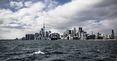 Toronto Skyline Feb 2 2017 (G. Maxwell) Tags: 2017 places ontario toronto lakeontario zuiko winter waves olympus landscapeseascape lakes clouds olym714mmf28wideangle posonpier