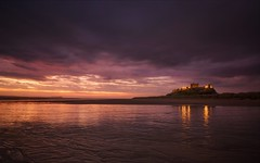 Band of light (Captain Nikon) Tags: northumberland bamburghcastle bamburgh northeast coastal coast beach northsea dawn reflections starburst moody castle nikond7000 sigma1020mmf4