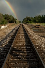 Railroads and Rainbows (Let Ideas Compete) Tags: railroad sky usa storm weather vanishingpoint rainbow colorado pattern lafayette traintracks perspective tracks railway stormy straight parallax distance parallel traintrack railroadtracks parallellines potofgold railroadtrack speciallight baselineroad downtheline lafayettecolorado lafayetteco lafayettecoloradolafayettecoloradolafayette colafayetteco