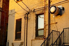 Temperance 1 (andrew.cantarutti) Tags: old windows sunset reflection building brick window yellow warm bricks wires worn