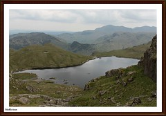 Stickle-tarn (stu.bloggs..Dont do Sundays) Tags: summer cliff mountains water june landscape scenery rocks cloudy path lakedistrict scenic climbing cumbria fells views paths tarn mountainlake lakeland stickletarn paveyark rockyoutcrops