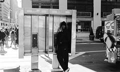 Phone Booth - Manhattan - November 2016 (A Screaming Comes Across the Sky) Tags: nikon nikkor 35mm fs8 ai film analog analogue emulsion black white bw street nyc new york city manhattan trix 400 kodak blackandwhite monochrome
