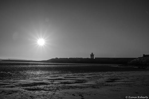 Sunburst over the lighthouse