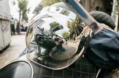 Visor reflection selfie (Eric Flexyourhead) Tags: chuoku 中央区 kobe kobeshi 神戸市 hyogo 兵庫県 kansai 関西地方 japan 日本 city urban street bike scooter helmet visor shiny reflection shallowdepthoffield ricohgr