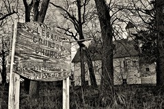 The Country Church (slammerking) Tags: country countryroads abandoned church sign weatherd trees blackwhite bw monochrome kansas forgotten