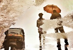 Puddlegram, India (Mark Fearnley Photography) Tags: silhoutte digitalart art india tuktuk rain iphone6 iphone colour puddlegram umbrella