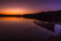Shadow Casting (jeanmarieshelton) Tags: light sunset sky sunlight lake nature water colors clouds landscape boat nikon silverlake jeanmarie jeanmarieshelton