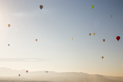 Balloons. (arturii!) Tags: morning sky mountains hot nature up sunrise landscape flying colorful europe balloon catalonia full points heat catalunya dots viewpoint globo globus igualada europeanballonfestival