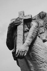 b&w #1 362 (butisitartphoto) Tags: sculpture art broken cemetery grave statue angel headless wings cross decay weathered
