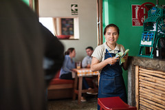 A young waitress at La Picantería (laskaproject) Tags: travel portrait food woman green peru southamerica girl face restaurant cafe counter lima traditional young culture local waitress peruvian lapicanteria