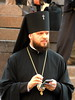 Priest (markb120) Tags: priest clergyman minister chaplain parson reverend christian chain chainlet cap hat header banner cross x mark rood black beard beaver head brain loaf pate noggin jowl arms hands phone device