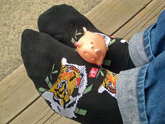 The pig and the tiger (manganite) Tags: people men feet fashion socks japan digital fun toys pig kyoto funny asia thomas tiger october2005 style plastic casio jeans pigs temples nippon kansai gn nihon stylish toji plasticanimal october152005 manganite japanschwein badeschwein date:year=2005 date:month=october date:day=15
