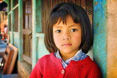 little girl in red - portrait girl red asia colors 2002 travel nepal serious phitar kathmandu little